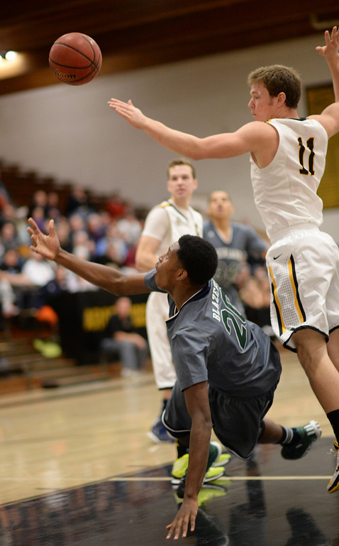 . CENTENNIAL, CO. JANUARY 18: De\'Ron Davis of Overland High School (20) missed the shot by Ethan Brunhofer of Arapahoe High School (11) in the 2nd half of the game at Arapahoe High School. Centennial Colorado. January 18. 2014. Arapahoe won 62-54.  (Photo by Hyoung Chang/The Denver Post)