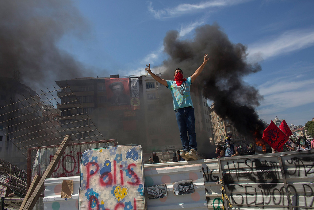 . A protester stands on top of a barricade during a demonstration near Taksim Square on June 11, 2013 in Istanbul, Turkey.   (Photo by Lam Yik Fei/Getty Images)