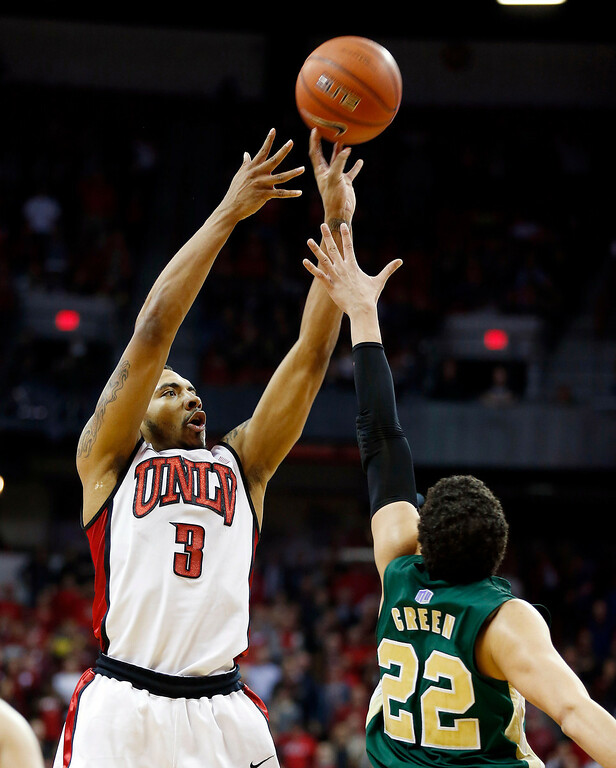 . UNLV\'s Anthony Marshall hits a shot over Colorado State\'s Dorian Green for the lead during the final moments of the second half of an NCAA college basketball game on Wednesday, Feb. 20, 2013, in Las Vegas. UNLV defeated Colorado State 61-59. (AP Photo/Isaac Brekken)