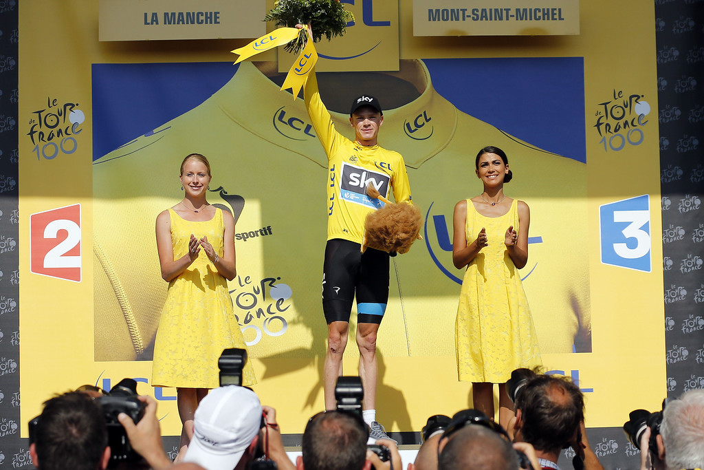 . Britain\'s Christopher Froome celebrates his overall leader\'s yellow jersey on the podium at the end of the 33 km individual time-trial and eleventh stage of the 100th edition of the Tour de France cycling race on July 10, 2013 between Avranches and Mont-Saint-Michel, northwestern France.     JEFF PACHOUD/AFP/Getty Images
