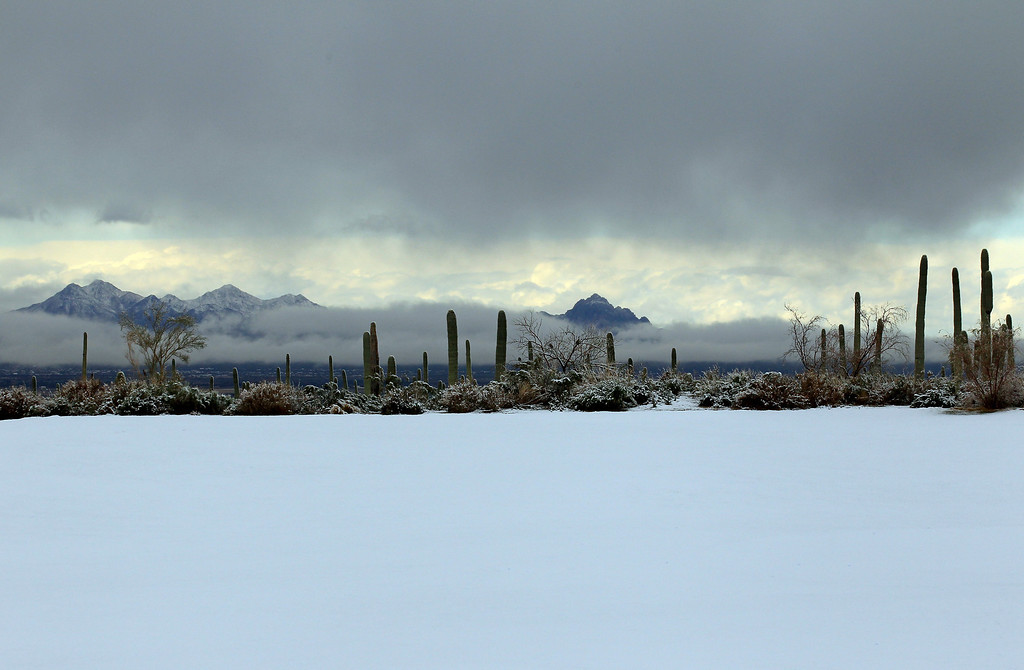 . MARANA, AZ - FEBRUARY 20:  Snow covers the driving range as play was suspended during the first round of the World Golf Championships - Accenture Match Play at the Golf Club at Dove Mountain on February 20, 2013 in Marana, Arizona.  (Photo by Jed Jacobsohn/Getty Images)