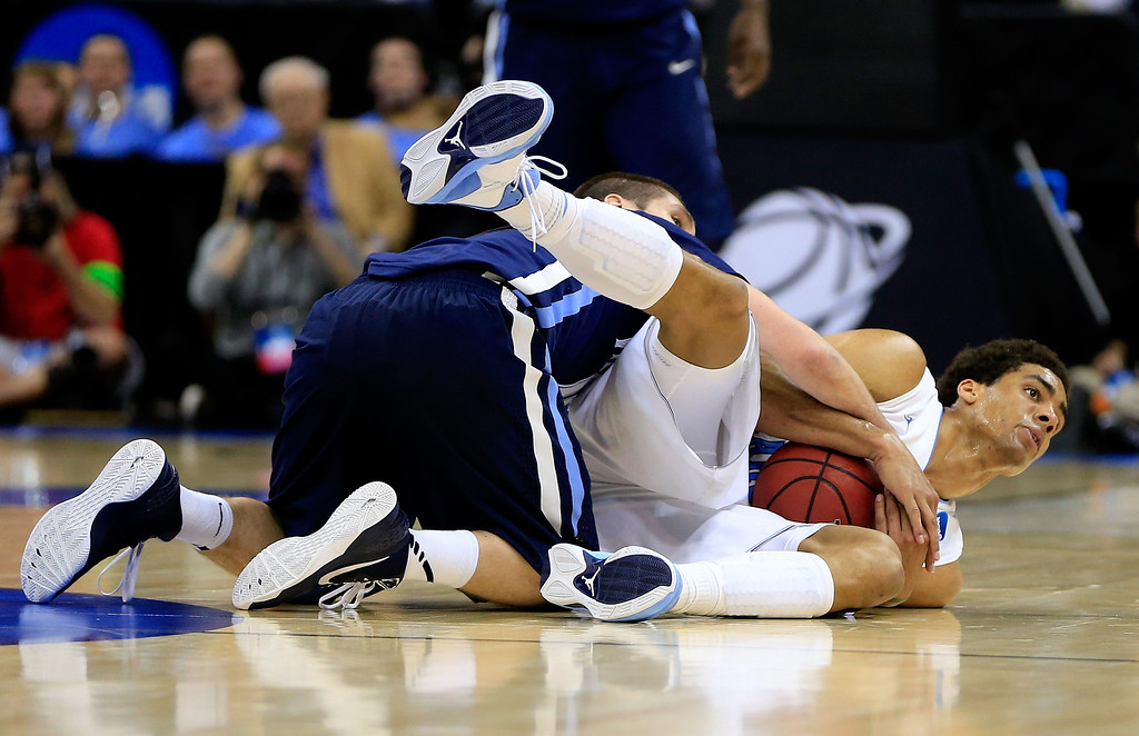 . KANSAS CITY, MO - MARCH 22: Ryan Arcidiacono #15 of the Villanova Wildcats fouls Reggie Bullock #35 of the North Carolina Tar Heels in the first half during the second round of the 2013 NCAA Men\'s Basketball Tournament at the Sprint Center on March 22, 2013 in Kansas City, Missouri.  (Photo by Jamie Squire/Getty Images)