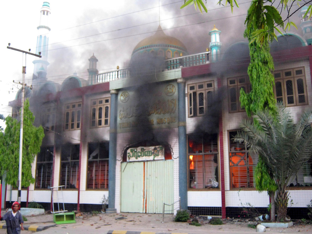 . In this Thursday, March. 21, 2013 photo, smoke billows from a burning mosque following ethnic unrest between Buddhists and Muslims in Meikhtila, Mandalay division, about 550 kilometers (340 miles) north of Yangon, Myanmar.  (AP Photo)