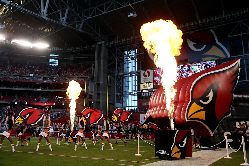 . GLENDALE, AZ - OCTOBER 17: The Arizona Cardinals take the field before a game against the Seattle Seahawks at the University of Phoenix Stadium on October 17, 2013 in Glendale, Arizona.  (Photo by Christian Petersen/Getty Images)