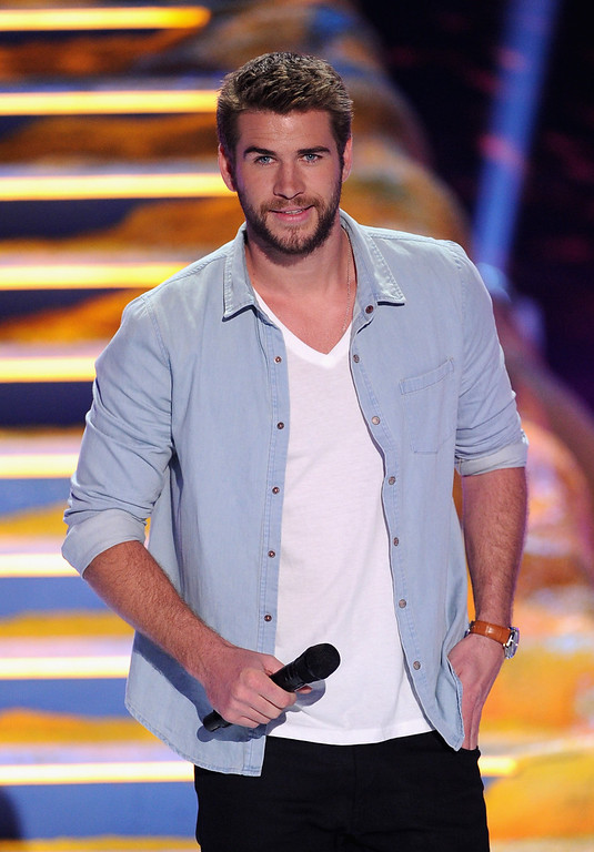 . Actor Liam Hemsworth speaks onstage during the Teen Choice Awards 2013 at Gibson Amphitheatre on August 11, 2013 in Universal City, California.  (Photo by Kevin Winter/Getty Images)