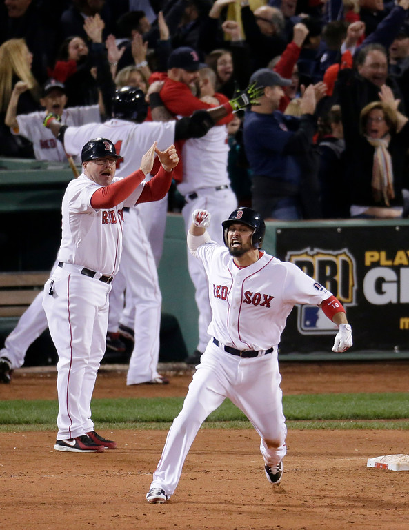 . Boston Red Sox\'s Shane Victorino, front, celebrates his grand slam against the Detroit Tigers as he rounds first base in the seventh inning during Game 6 of the American League baseball championship series on Saturday, Oct. 19, 2013, in Boston. (AP Photo/Charlie Riedel)