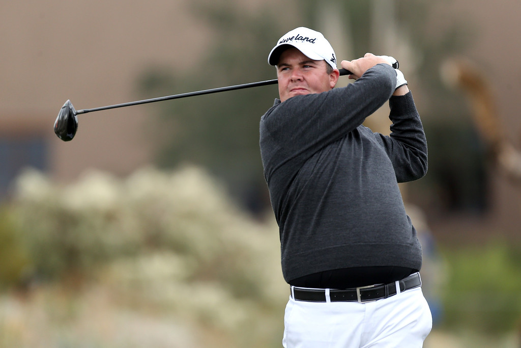 . MARANA, AZ - FEBRUARY 21:  Shane Lowry of Ireland hits his tee shot on the 10th hole during the first round of the World Golf Championships - Accenture Match Play at the Golf Club at Dove Mountain on February 21, 2013 in Marana, Arizona. Round one play was suspended on February 20 due to inclimate weather and is scheduled to be continued today.  (Photo by Andy Lyons/Getty Images)