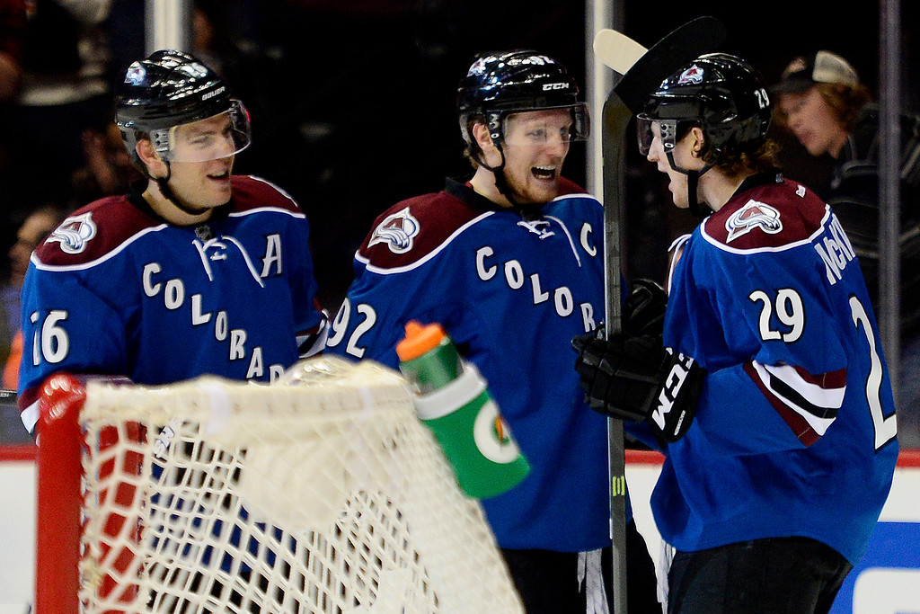 . Gabriel Landeskog (92) of the Colorado Avalanche celebrates his goal with teammates Paul Stastny (26) and Nathan MacKinnon (29) against the Winnipeg Jets during the third period of action. The Colorado Avalanche lost 2-1 to the Winnipeg Jets at the Pepsi Center on Sunday, December 29, 2013. (Photo by AAron Ontiveroz/The Denver Post)