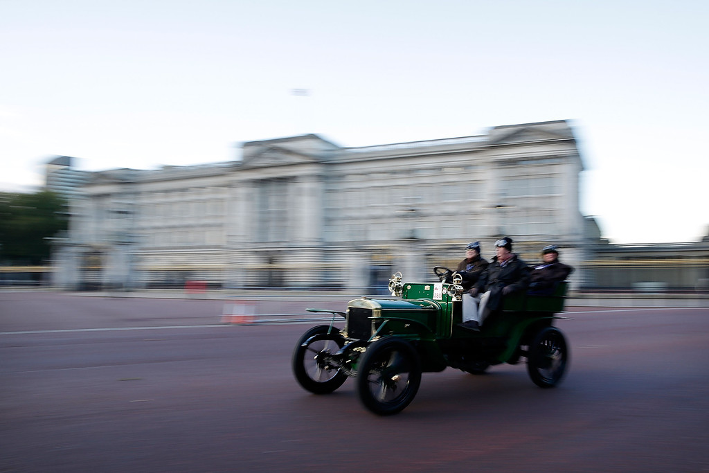 . Participants pass Buckingham Palace, close to the start of the Royal Automobile Club\'s annual Veteran Car Run in Hyde Park on November 3, 2013 in London, England. Around 500 eligible pre-1905 cars take part in The Royal Automobile Club\'s annual 60-mile drive from Hyde Park in central London to the seafront on the Sussex resort of Brighton. It is the longest running motoring event in the world, and attracts entrants from across the globe.  (Photo by Matthew Lloyd/Getty Images)