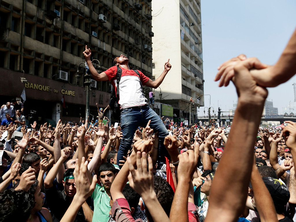 . Aug. 16, 2013: Supporters of Egypt\'s ousted President Mohammed Morsi chant slogans against Egyptian Defense Minister Gen. Abdel-Fattah el-Sissi before clashes with Egyptian security forces in Ramses Square, in downtown Cairo, Friday, Aug. 16, 2013. Heavy gunfire rang out throughout Cairo as tens of thousands of Muslim Brotherhood supporters clashed with armed vigilantes in the fiercest street battles to engulf the capital since the country\'s Arab Spring uprising. The clashes killed 173 people nationwide, including police officers. (AP Photo/Hassan Ammar)