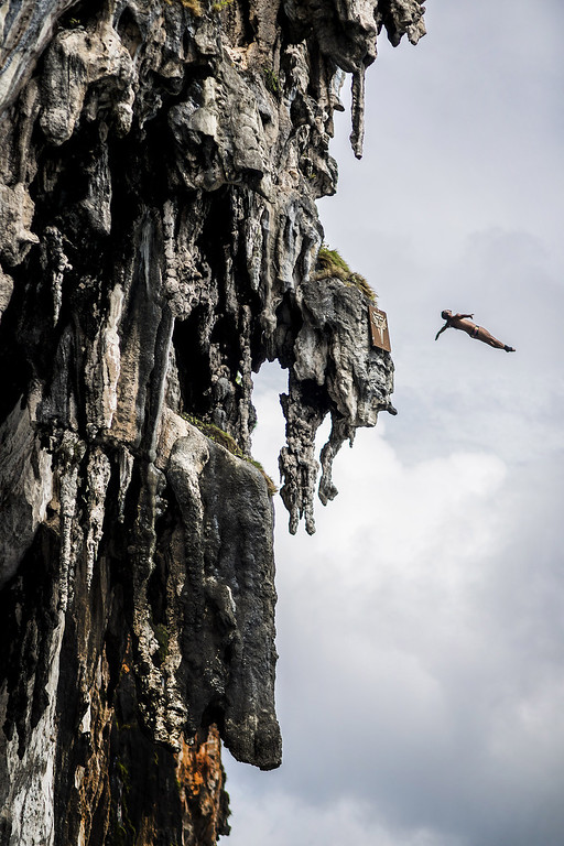 . In this handout image provided by Red Bull, Orlando Duque of Colombia dives from a 25 meter rock at Viking Caves in the Andaman Sea during competition on the fifth day of the final stop of the 2013 Red Bull Cliff Diving World Series on October 24, 2013 at Phi Phi Island, Thailand. (Photo by Dean Treml/Red Bull via Getty Images)