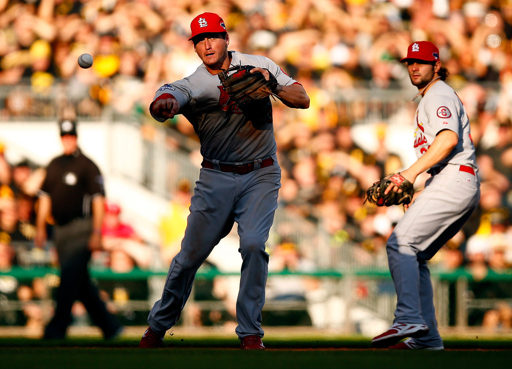 . David Freese #23 of the St. Louis Cardinals throws to first base against the Pittsburgh Pirates during Game Three of the National League Division Series at PNC Park on October 6, 2013 in Pittsburgh, Pennsylvania.  (Photo by Justin K. Aller/Getty Images)