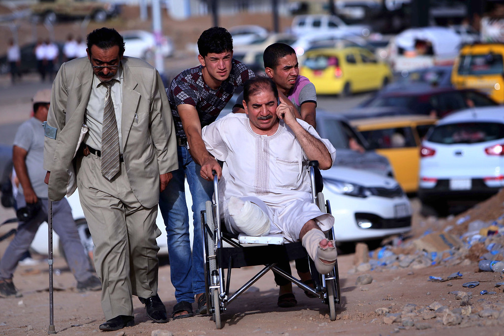 . An Iraqi man in wheelchair fleeing violence in the northern Nineveh province arrives at a Kurdish checkpoint in Aski kalak, 40 kms West of Arbil, in the autonomous Kurdistan region, on June 11, 2014. Since the Islamic State of Iraq and the Levant began their spectacular assault in Mosul late on June 9, militants have captured a large swathe of northern  and north-central Iraq, prompting as many as half a million people to flee their homes. SAFIN HAMED/AFP/Getty Images