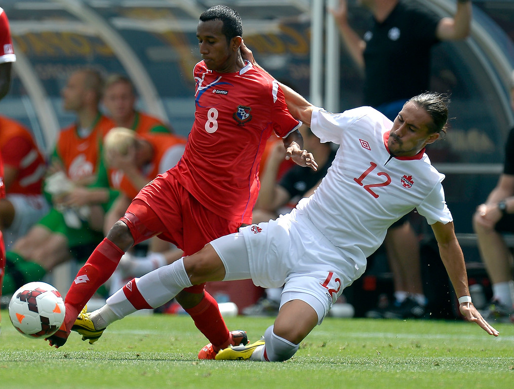 . Issey Nakajima-Farran #12 of Canada slides in to kick the ball away from Marcos Sanchez #8 of Panama during the seond half of the CONCACAF Gold Cup soccer game July 14, 2013 at Sports Authority Field at Mile High. (Photo By John Leyba/The Denver Post)