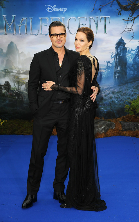 """. Brad Pitt and Angelina Jolie attend a private reception as costumes and props from Disney\'s \""""Maleficent\"""" are exhibited in support of Great Ormond Street Hospital at Kensington Palace on May 8, 2014 in London, England.  (Photo by Eamonn M. McCormack/Getty Images)"""