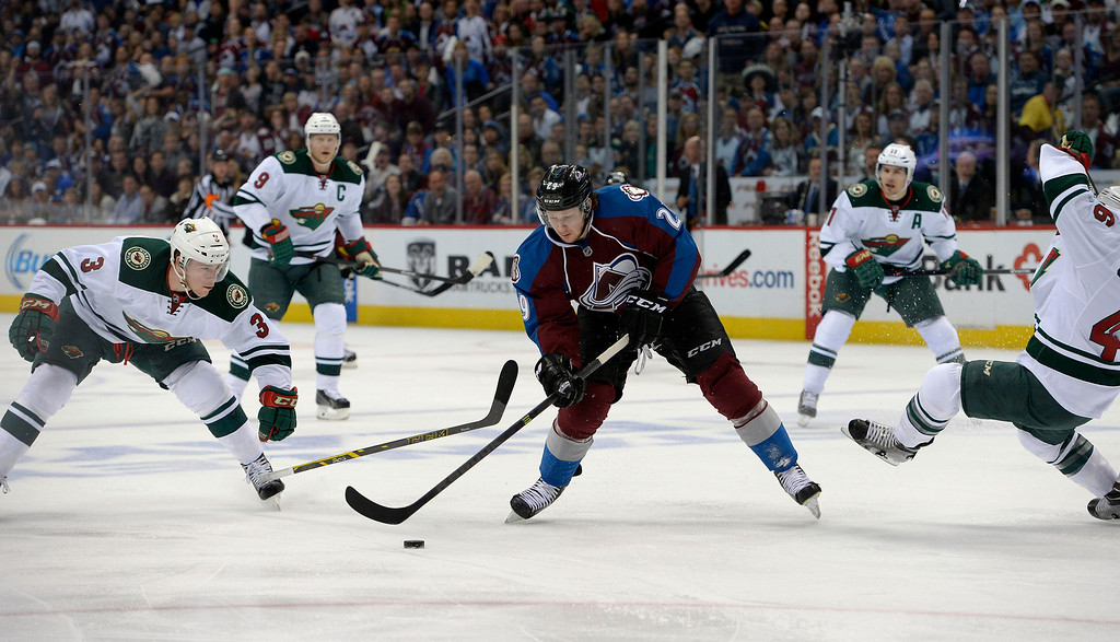 . Nathan MacKinnon (29) of the Colorado Avalanche fires in the first Avalanche goal of the game during the first period of action. The Colorado Avalanche hosted the Minnesota Wild in the first round of the Stanley Cup Playoffs at the Pepsi Center in Denver, Colorado on Saturday, April 19, 2014. (Photo by John Leyba/The Denver Post)