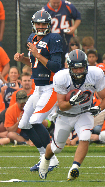 . Denver Broncos QB Brock Osweiler (17) hands off to Jacob Hester (22) during training camp July 29, 2013 at Dove Valley. (Photo By John Leyba/The Denver Post)