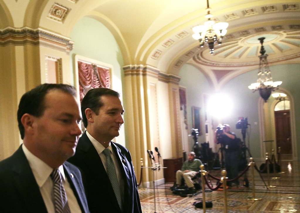. WASHINGTON, DC - OCTOBER 16:  U.S. Sen. Ted Cruz (R-TX) (R) and Sen. Mike Lee (R-UT) (L) arrive for a vote October 16, 2013 on Capitol Hill in Washington, DC. On the 16th day of a government shutdown, the Senate has approved a bill to reopen the government until January 15 and raise the nation\'s debt ceiling until February 7, 2014.  (Photo by Alex Wong/Getty Images)