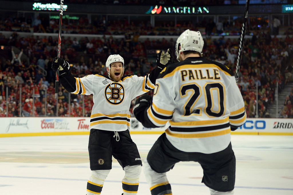 . CHICAGO, IL - JUNE 15:  Daniel Paille #20 (R) and Andrew Ference #21 of the Boston Bruins celebrate after Paille scored the game-winning goal in the first overtime against the Boston Bruins in Game Two of the NHL 2013 Stanley Cup Final at United Center on June 15, 2013 in Chicago, Illinois.  (Photo by Harry How/Getty Images)