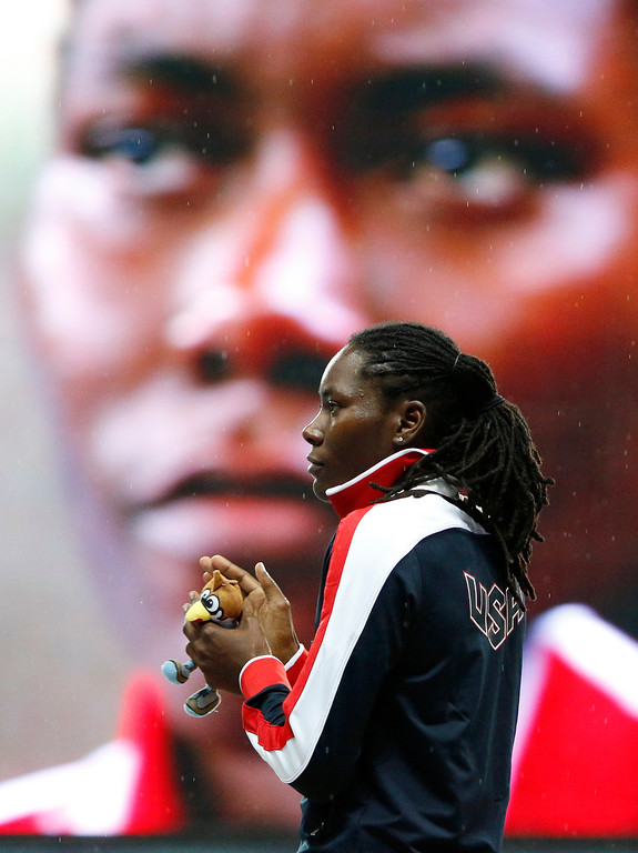 . United States\' Brittney Reese waits on the podium for her gold medal during the medals ceremony for the women\'s long jump at the World Athletics Championships in the Luzhniki stadium in Moscow, Russia, Sunday, Aug. 11, 2013. (AP Photo/Alexander Zemlianichenko)