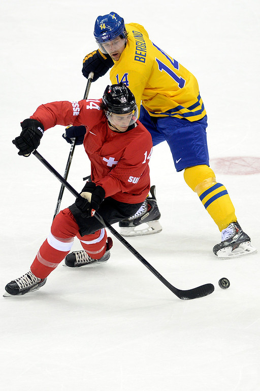 . Sweden\'s Patrik Berglund defends Switzerland\'s Roman Wick during the action at Bolshoy Arena. Sochi 2014 Winter Olympics on Friday, February 14, 2014. (Photo by AAron Ontiveroz/The Denver Post)