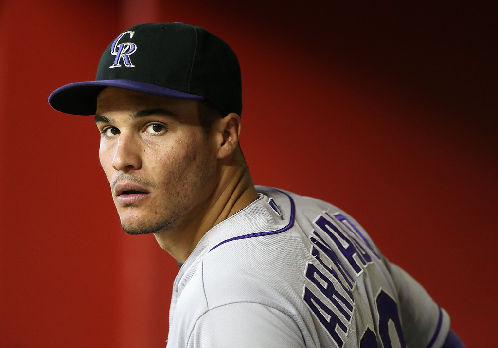 . Nolan Arenado #28 of the Colorado Rockies watches from the dugout during the MLB game against the Arizona Diamondbacks at Chase Field on April 30, 2014 in Phoenix, Arizona.  (Photo by Christian Petersen/Getty Images)