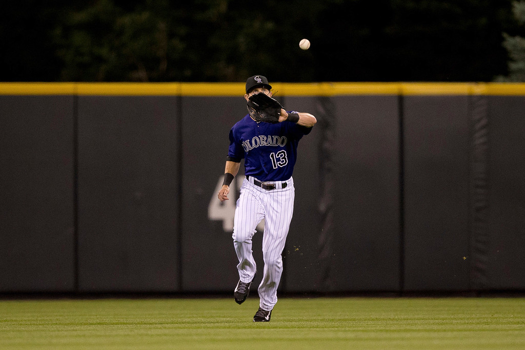 . Center fielder Drew Stubbs #13 of the Colorado Rockies makes a catch on a ball off the bat of Jason Heyward (not pictured) of the Atlanta Braves during the ninth inning at Coors Field on June 9, 2014 in Denver, Colorado.  (Photo by Justin Edmonds/Getty Images)