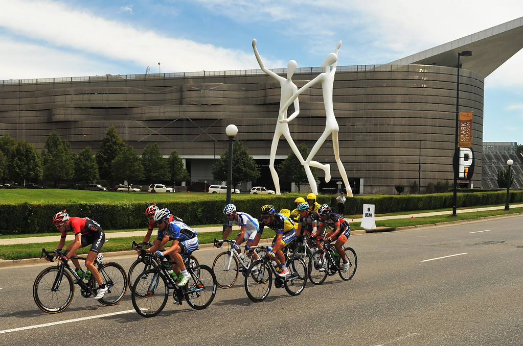 . Cyclists pass by the Denver Performing Art Complex during the 75-mile 7th stage of the 2013 USA Pro Challenge race in Denver August 25, 2013. (Photo by Hyoung Chang/The Denver Post)