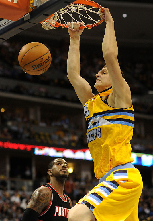 . DENVER, CO. - NOVEMBER 1:  Denver center Timofey Mozgov threw down a dunk in the first half. The Denver Nuggets hosted the Portland Trail Blazers Friday night, November 1, 2013 at the Pepsi Center.  Photo By Karl Gehring/The Denver Post