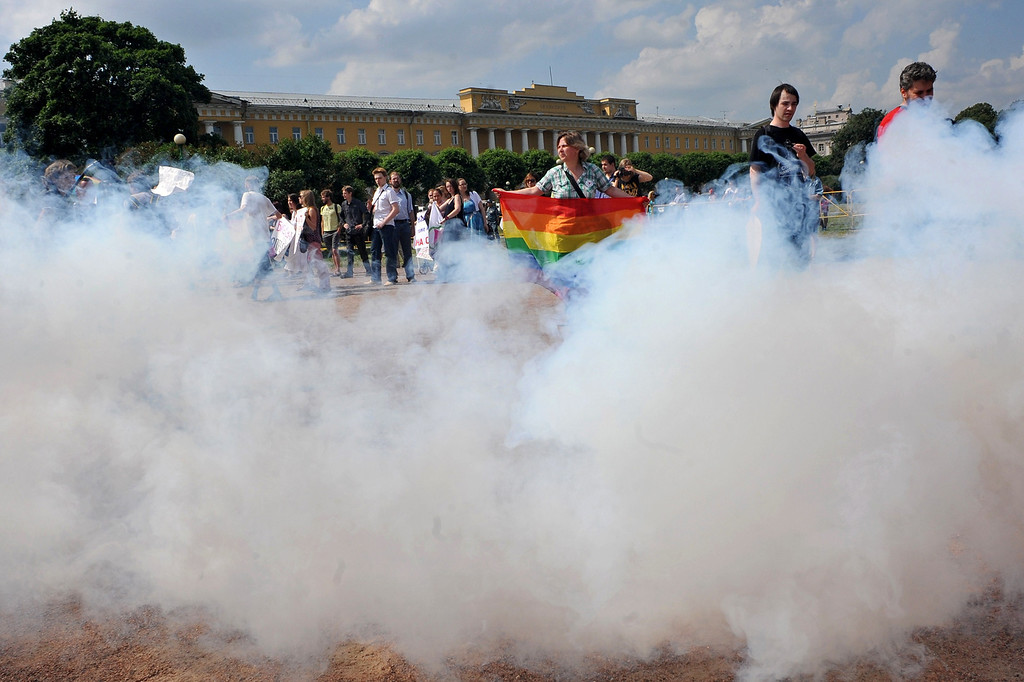 . Gay rights activists take part in a gay pride event in Saint Petersburg on June 29, 2013. Russian police arrested dozens of people on June 29 after clashes erupted in the city of Saint Petersburg between pro- and anti-gay demonstrators. OLGA MALTSEVA/AFP/Getty Images