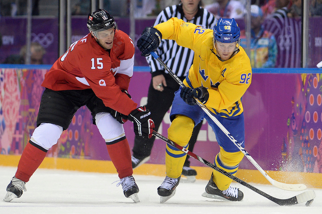. Gabriel Landeskog (92) of Sweden controls the puck as Ryan Getzlaf (15) of Canada defends during the second period of the men\'s ice hockey gold medal game. Sochi 2014 Winter Olympics on Sunday, February 23, 2014 at Bolshoy Ice Arena. (Photo by AAron Ontiveroz/ The Denver Post)
