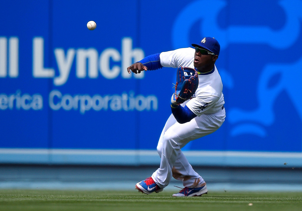 . Los Angeles Dodgers right fielder Yasiel Puig makes a catch on a ball hit by Colorado Rockies\' Jordan Pacheco during the fourth inning of a baseball game, Sunday, April 27, 2014, in Los Angeles. (AP Photo/Mark J. Terrill)