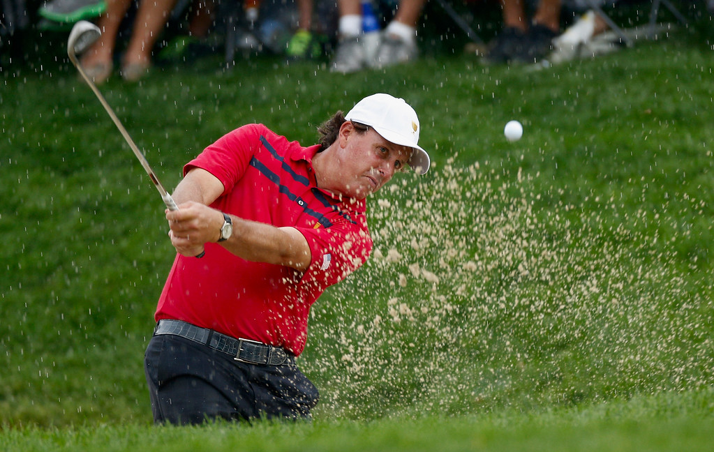 . DUBLIN, OH - OCTOBER 05:  Phil Mickelson of the U.S. Team plays a bunker shot on the 14th hole during the Day Three Four-ball Matches at the Muirfield Village Golf Club on October 5, 2013  in Dublin, Ohio.  (Photo by Gregory Shamus/Getty Images)