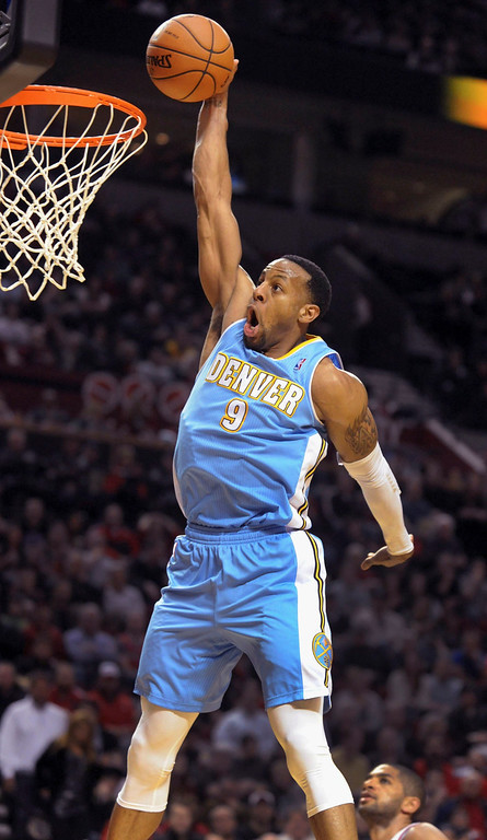 . Denver Nuggets shooting guard Andre Iguodala (9) goes up for a dunk during the third quarter of their NBA basketball game against the Portland Trail Blazers in Portland, Oregon February 27, 2013. The Denver Nuggets won the game 111-109.  REUTERS/Steve Dykes