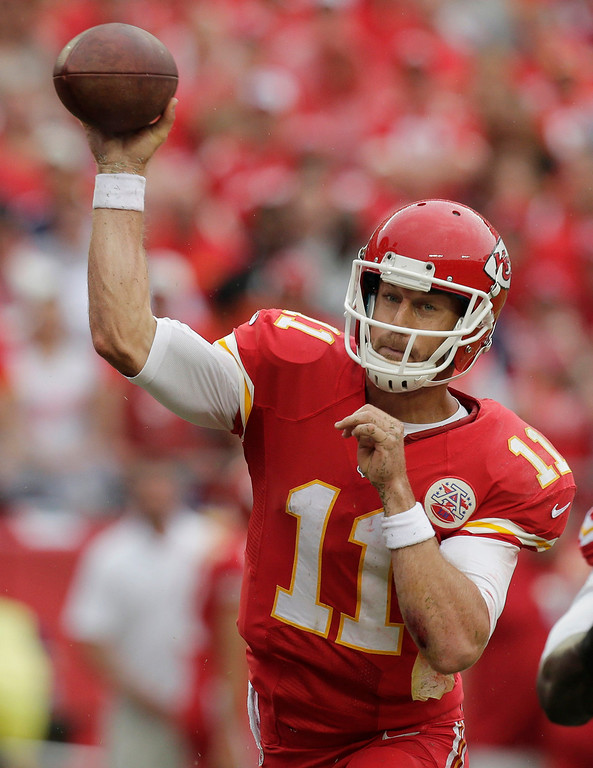 . Kansas City Chiefs quarterback Alex Smith throws a pass during the first half of an NFL football game against the Dallas Cowboys at Arrowhead Stadium in Kansas City, Mo., Sunday, Sept. 15, 2013. (AP Photo/Charlie Riedel)