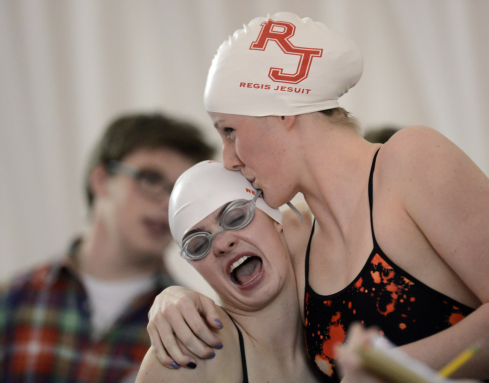 . Olympic gold medalist Missy Franklin of Regis Jesuit, right, hugs her teammate Madison Rose during the swimming meet against Highlands Ranch at Regis Jesuit swimming pool on Tuesday. Aurora. CO, January 8, 2013.  Hyoung Chang, The Denver Post