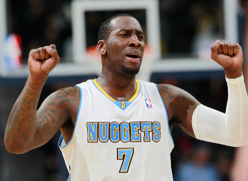 . Denver Nuggets forward J.J. Hickson reacts after a three-point basket by Portland Trail Blazers forward Nicolas Batum with only 42 seconds remaining in the in the fourth quarter of an NBA basketball game in Denver, Tuesday, Feb. 25, 2014. Portland won 100-95. (AP Photo/David Zalubowski)