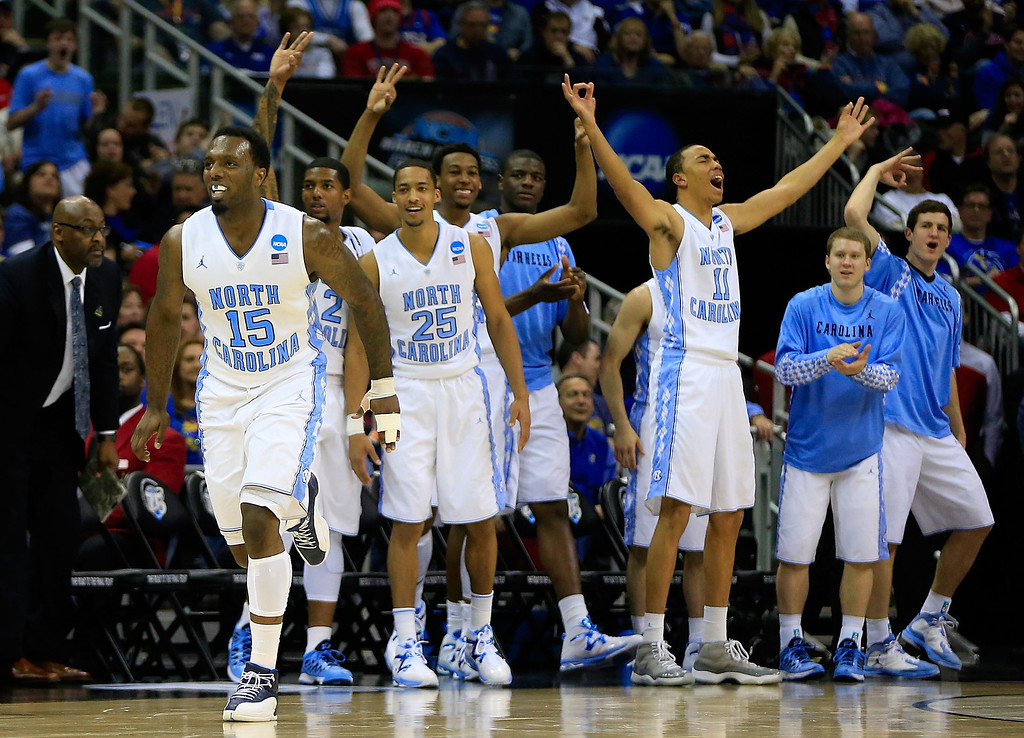 . KANSAS CITY, MO - MARCH 22:  P.J. Hairston #15 of the North Carolina Tar Heels and the bench celebrate in the second half against the Villanova Wildcats during the second round of the 2013 NCAA Men\'s Basketball Tournament at the Sprint Center on March 22, 2013 in Kansas City, Missouri.  (Photo by Jamie Squire/Getty Images)