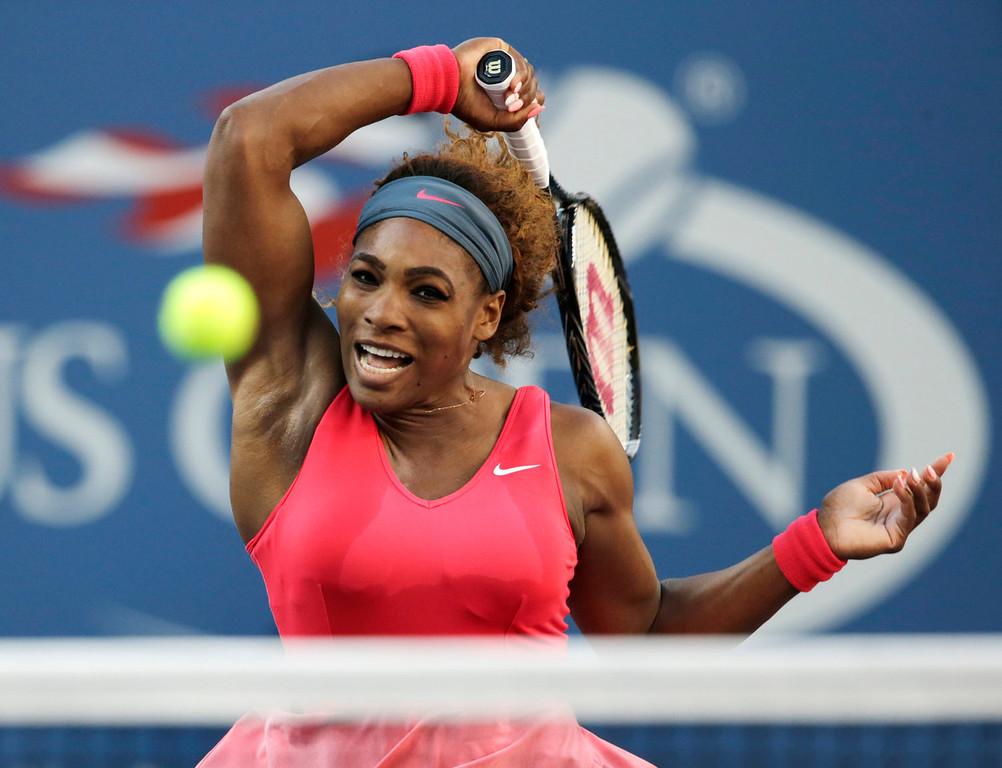 . Serena Williams returns a shot to Victoria Azarenka, of Belarus, during the women\'s singles final of the 2013 U.S. Open tennis tournament, Sunday, Sept. 8, 2013, in New York. (AP Photo/Charles Krupa)