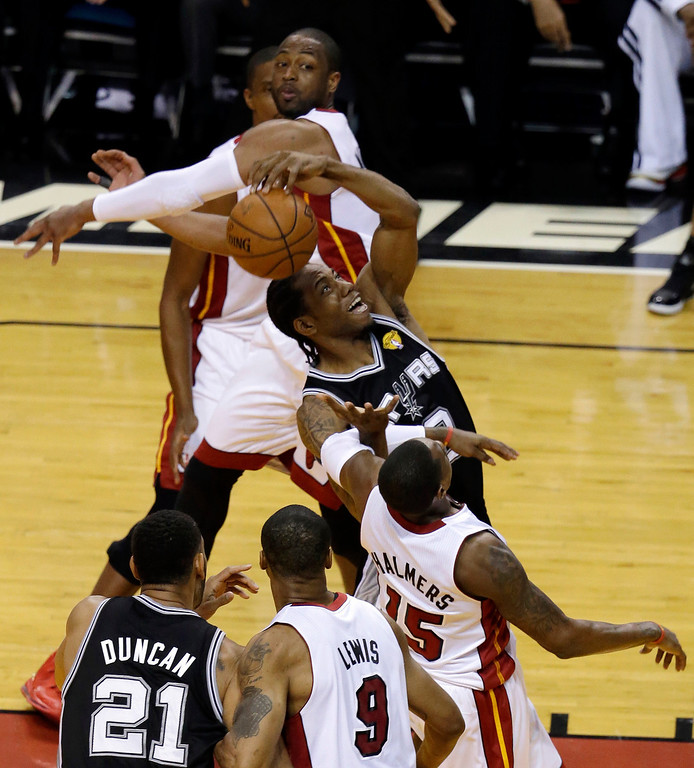 . San Antonio Spurs forward Kawhi Leonard (2) loses control of the ball against the Miami Heat in the first half in Game 3 of the NBA basketball finals, Tuesday, June 10, 2014, in Miami. (AP Photo/Lynne Sladky)