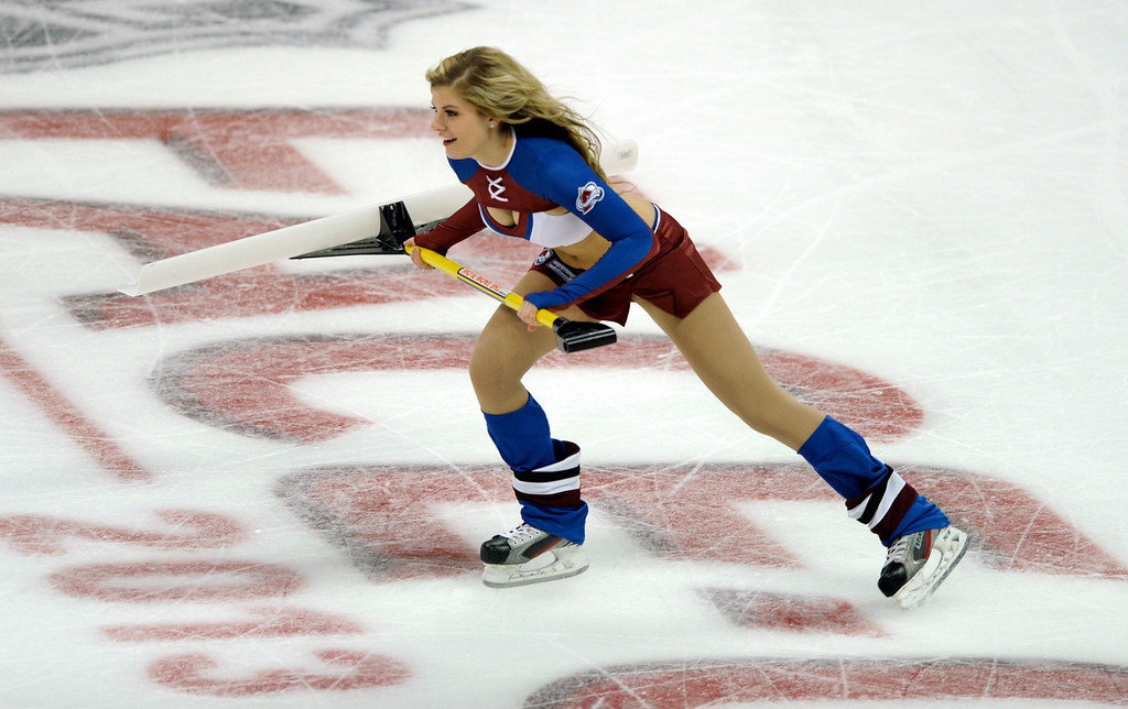 . DENVER, CO. - OCTOBER 02: One of the Avalanche ice girls came out to clean the playing surface in the second period. The Colorado Avalanche hosted the Anaheim Ducks at the Pepsi Center Wednesday night, October 2, 2013. Photo By Karl Gehring/The Denver Post