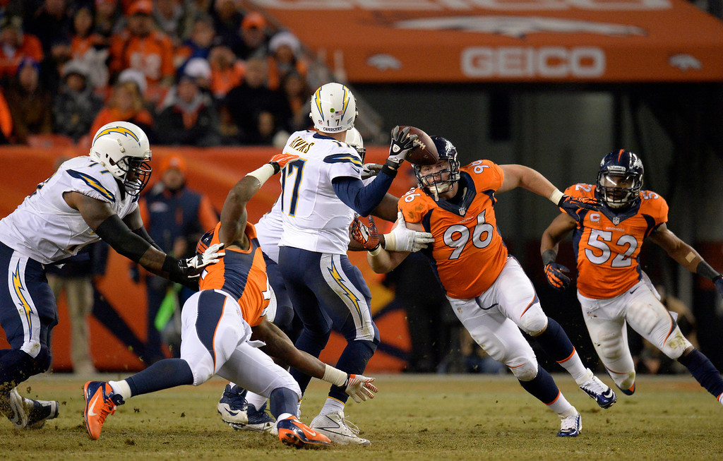 . DENVER, CO - DECEMBER 12: Denver Broncos defensive tackle Mitch Unrein (96) puts pressure on San Diego Chargers quarterback Philip Rivers (17) during the second quarter. The Denver Broncos vs. the San Diego Chargers at Sports Authority Field at Mile High in Denver on December 12, 2013. (Photo by John Leyba/The Denver Post)