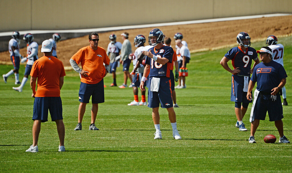 . Peyton Manning practices at Dove Valley in Centennial, August 21, 2014. The Denver Broncos take on the Houston Texans, in Denver on Saturday, in their third pre-season game. (Photo by RJ Sangosti/The Denver Post)