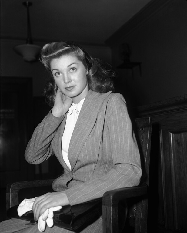 """. Esther Williams, former swimming champion now a movie actress, won a divorce from Dr. Leonard Kovner, Sept. 12, 1944, after testifying he maintained an attitude of criticism toward her and \""""treated me and my friends with superiority and contempt.\"""" (AP Photo/John T. Burns)"""