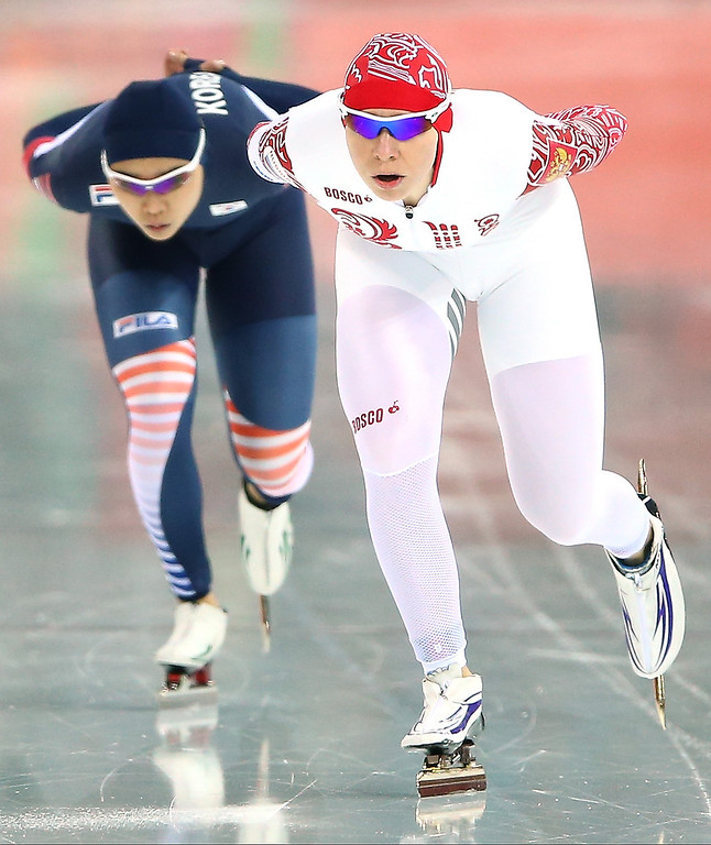 . Yuliya Skokova of Russia (R) and Shin Young Yang of South Korea compete during the Women\'s 3000m Speed Skating event during day 2 of the Sochi 2014 Winter Olympics at Adler Arena Skating Center on February 9, 2014 in Sochi, Russia.  (Photo by Streeter Lecka/Getty Images)
