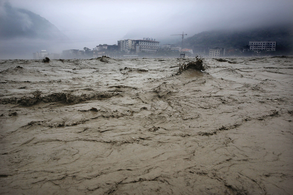 . Heavy flood waters sweeping through Beichuan in southwest China\'s Sichuan province on Tuesday, July 9, 2013. Rainstorms sweeping across parts of China have affected millions, causing landslides and disabling transportation in provinces such as Sichuan and Yunnan, state media reported.  AFP/Getty Images