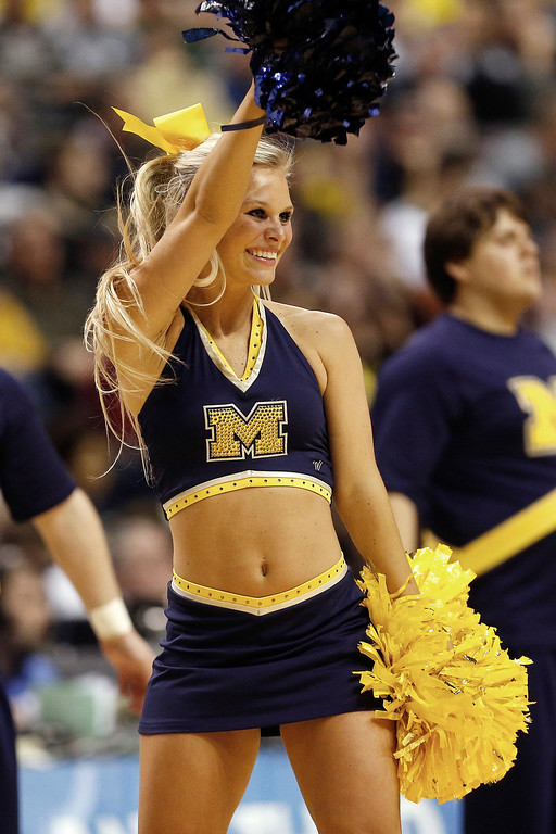 . A cheerleader fot eh Michigan Wolverines performs against the South Dakota State Jackrabbits during the second round of the 2013 NCAA Men\'s Basketball Tournament at at The Palace of Auburn Hills on March 21, 2013 in Auburn Hills, Michigan.  (Photo by Gregory Shamus/Getty Images)
