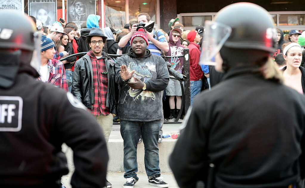 . Concert goers confront police in riot gear in front of the Fox Theater after a fight broke out causing a panic outside of the theater in Boulder, Colorado March 11, 2013.  Mark Leffingwell/Boulder Daily Camera