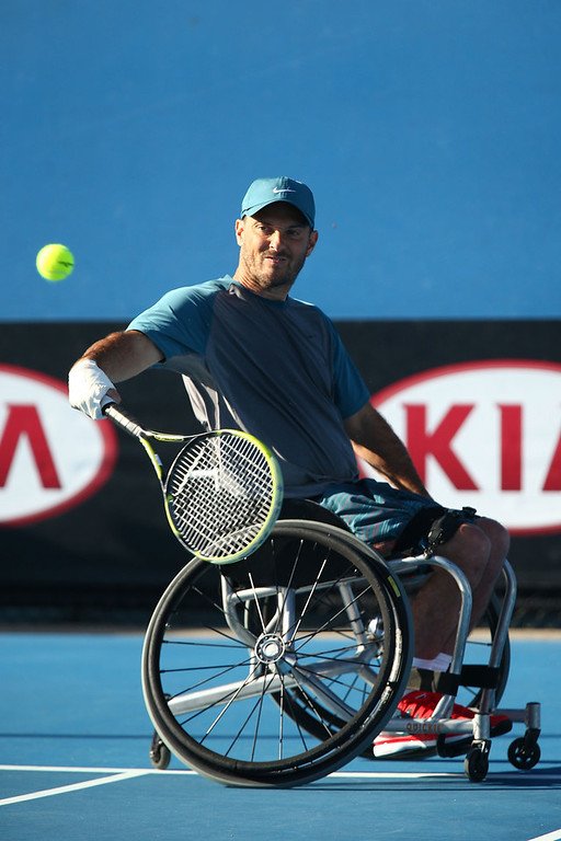 . David Wagner of the United States plays a backhand in the Quad Wheelchair Singles Final against Lucas Sitole of the United States during the 2014 Australian Open Wheelchair Championships at Melbourne Park on January 25, 2014 in Melbourne, Australia.  (Photo by Robert Prezioso/Getty Images)
