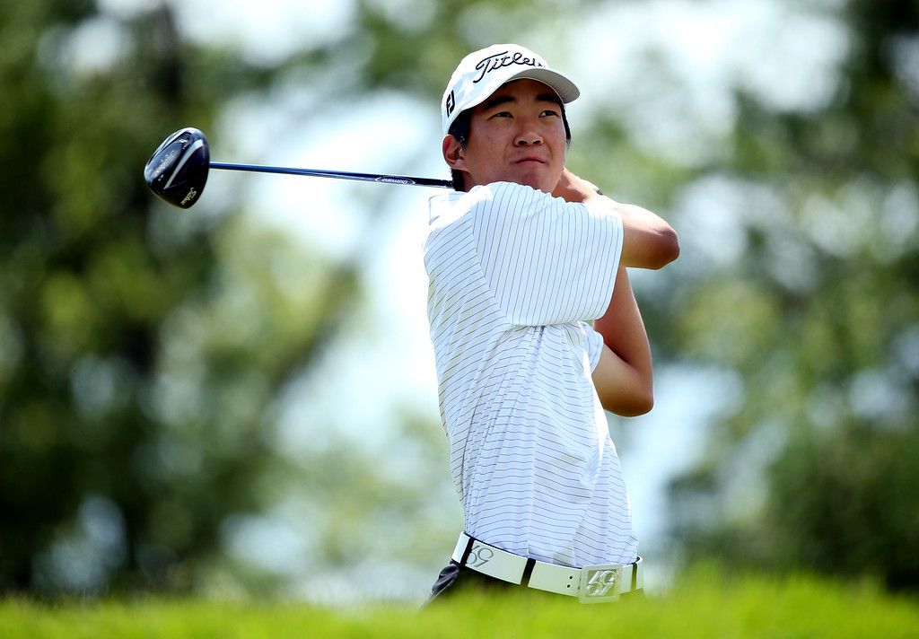 . Amateur Michael Kim of the United States hits his tee shot on the fourth hole during Round Three of the 113th U.S. Open at Merion Golf Club on June 15, 2013 in Ardmore, Pennsylvania.  (Photo by Andrew Redington/Getty Images)